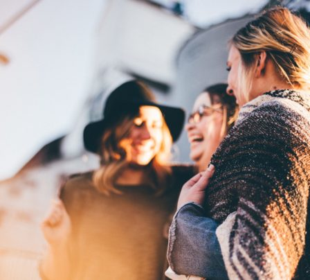 Three female language students having a laugh